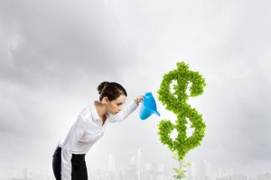woman watering money